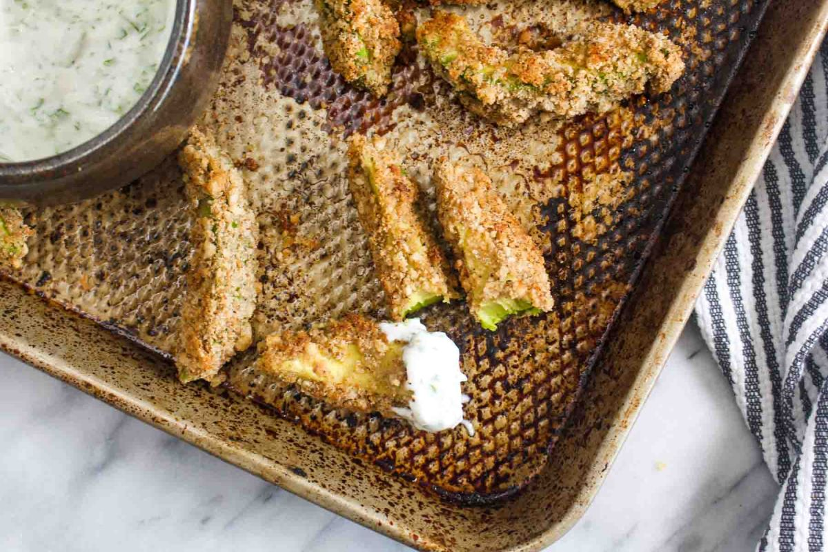 Avocado fries with cilantro lime dipping sauce bite