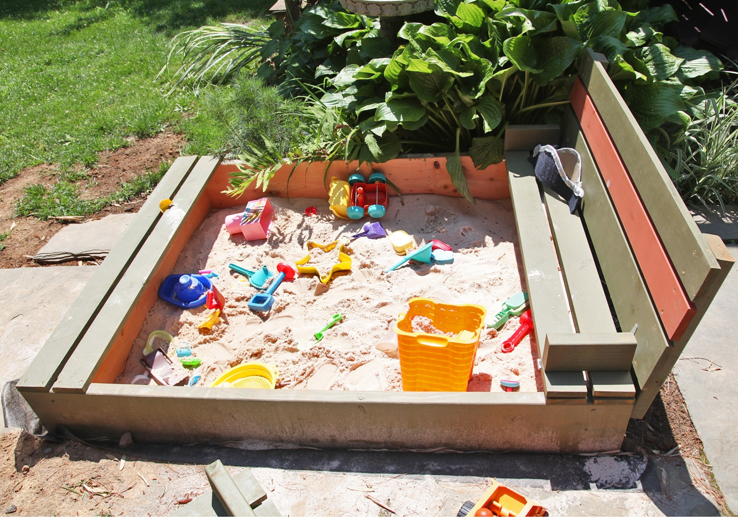 Diy sand box with bench cover