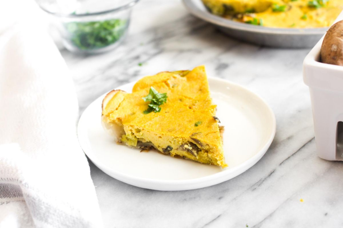 Slice of vegan mushroom and leek quiche