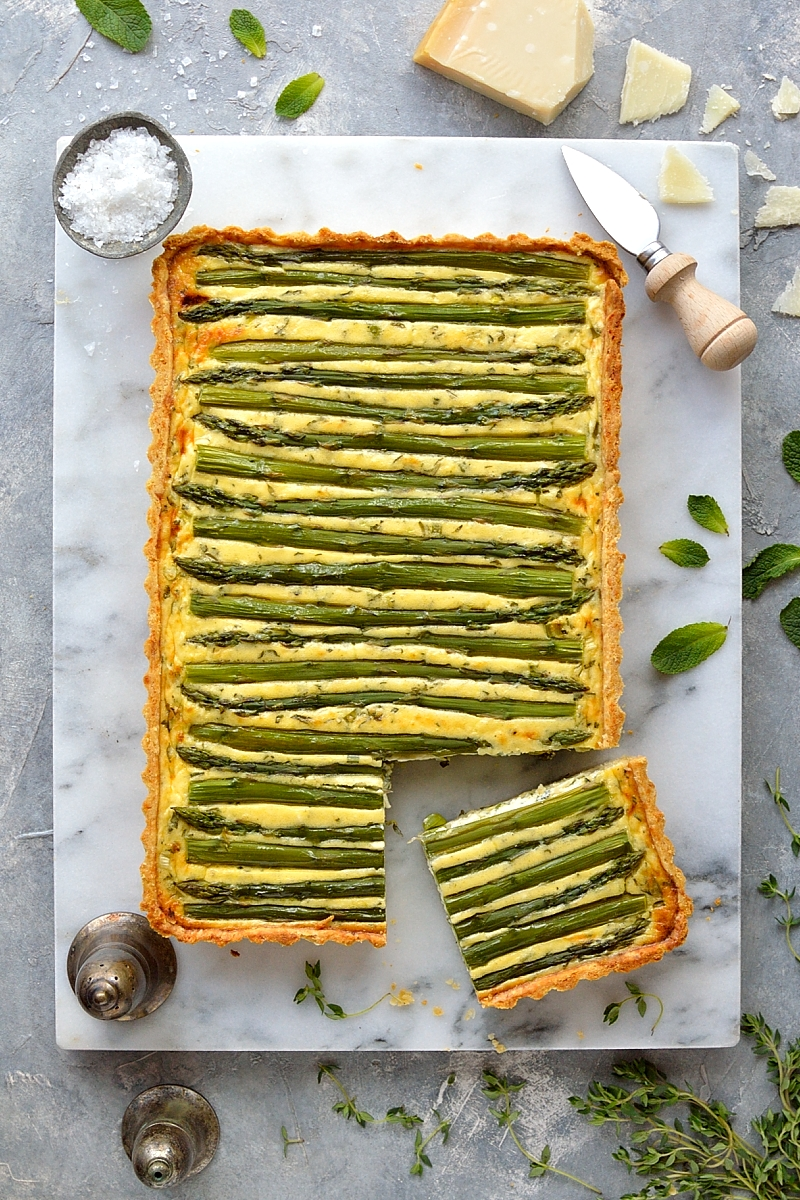 Spring vegetable and feta cheese tart - a stunning vegetarian tart made with asparagus, peas, scallions, feta cheese and parmesan pastry.