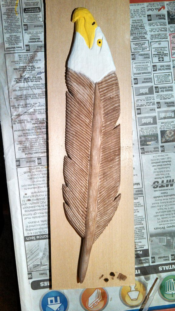 Carved and painted eagle feather