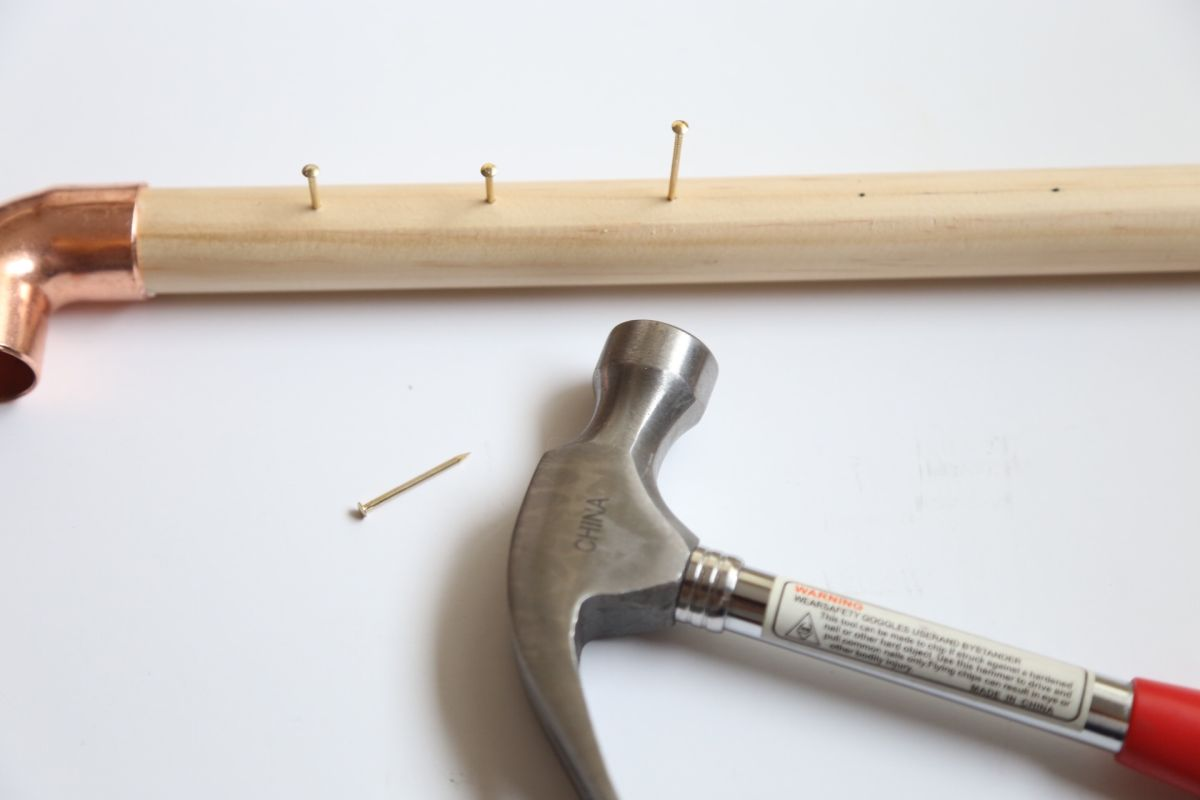 Diy jewelry stand carefully hammer the nails