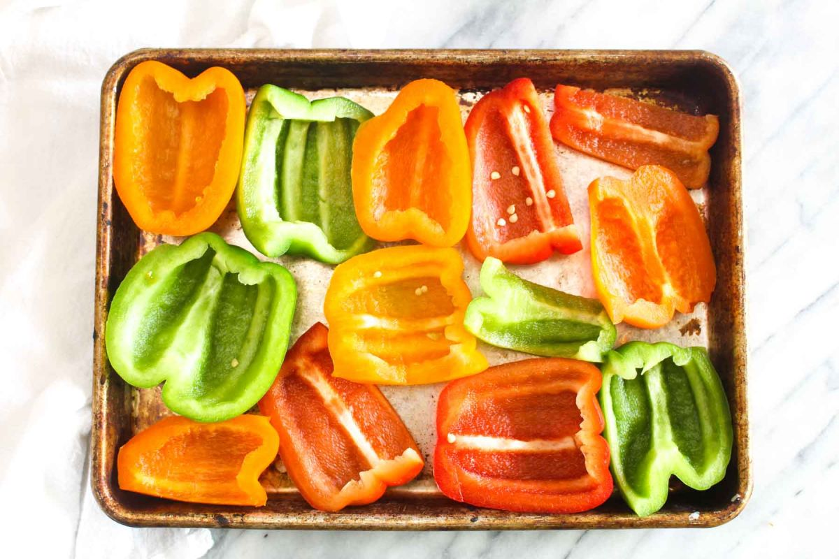 Grilled veggie fajita bowls slice the bell peppers