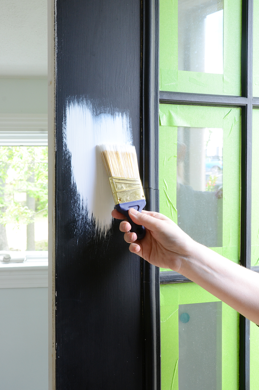 How to paint an exterior door coat of white primer