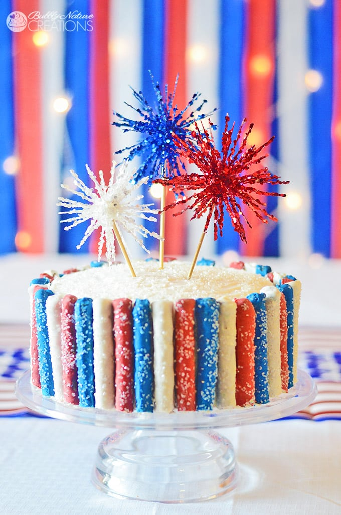 Amazing 4th of july cake with fireworks and red white and blue sparkle pretzels so fun1