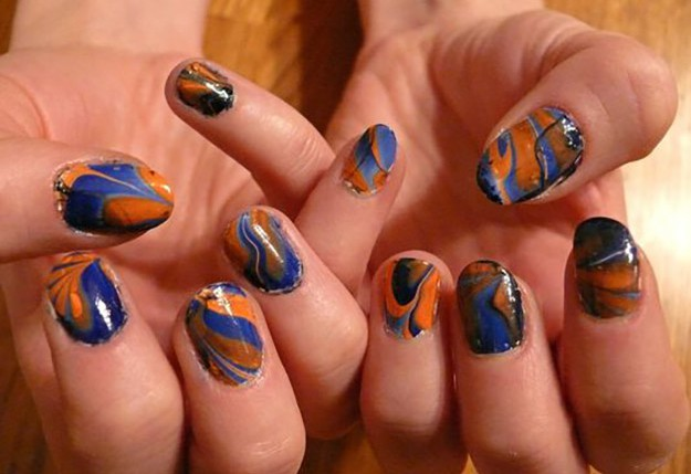 Blue and orange marbled nails