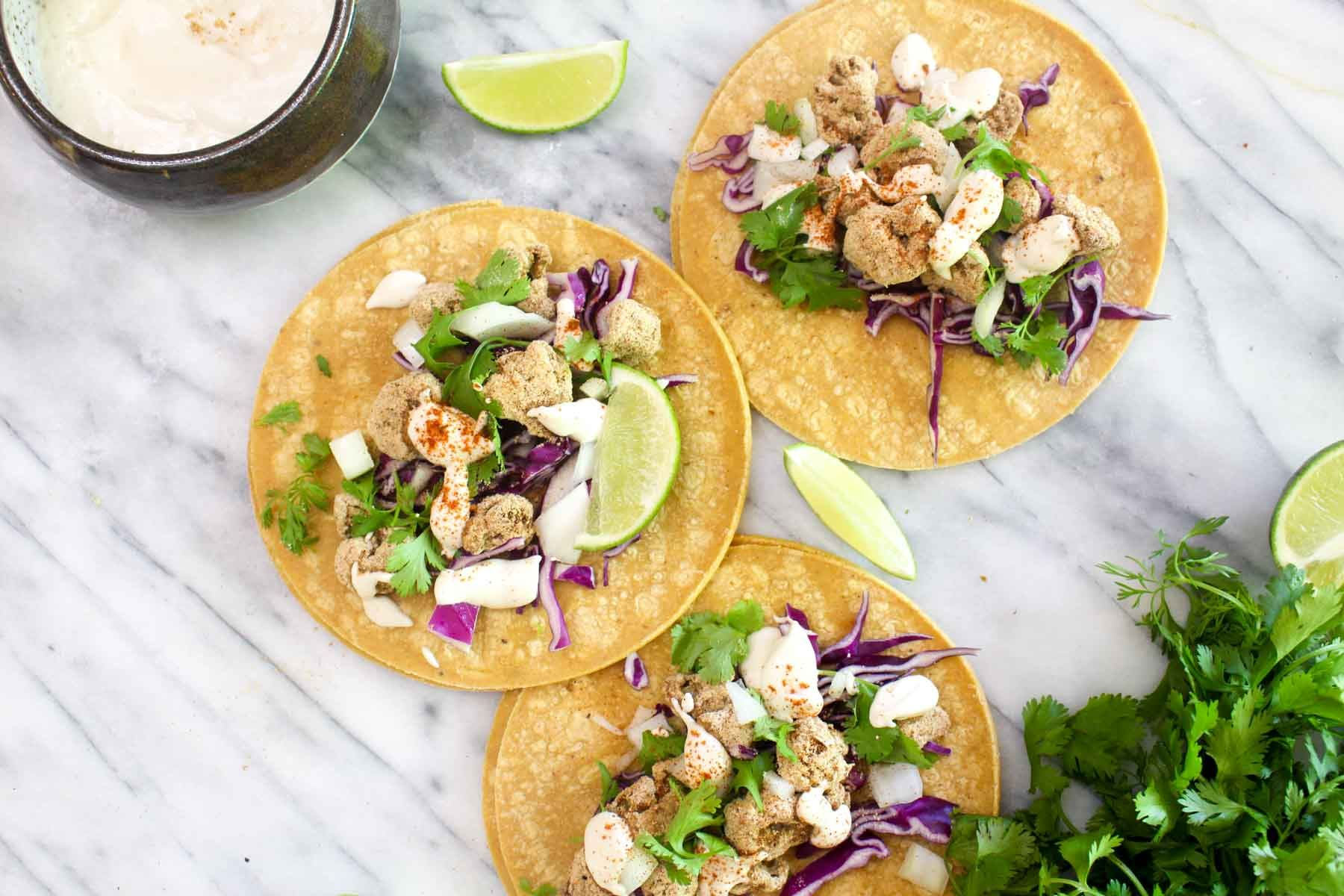 Crispy cauliflower tacos onion