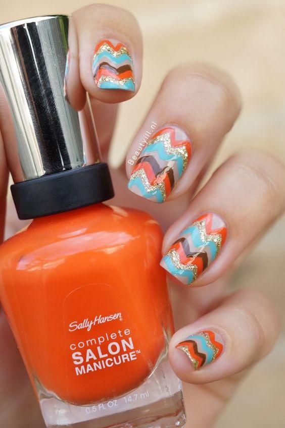 Orange and coloured chevron nails