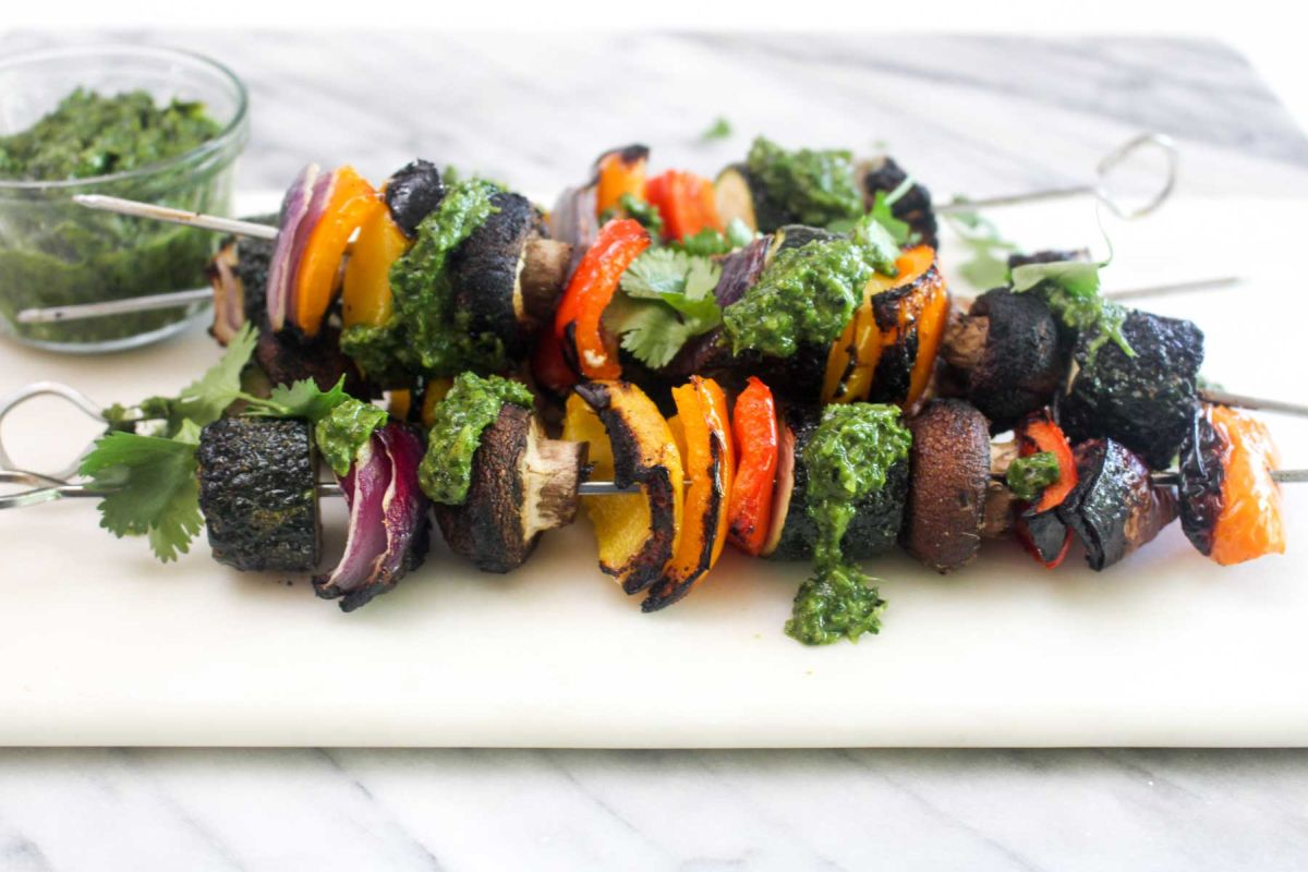 Simple vegetable kabobs with charred scallion chimichurri