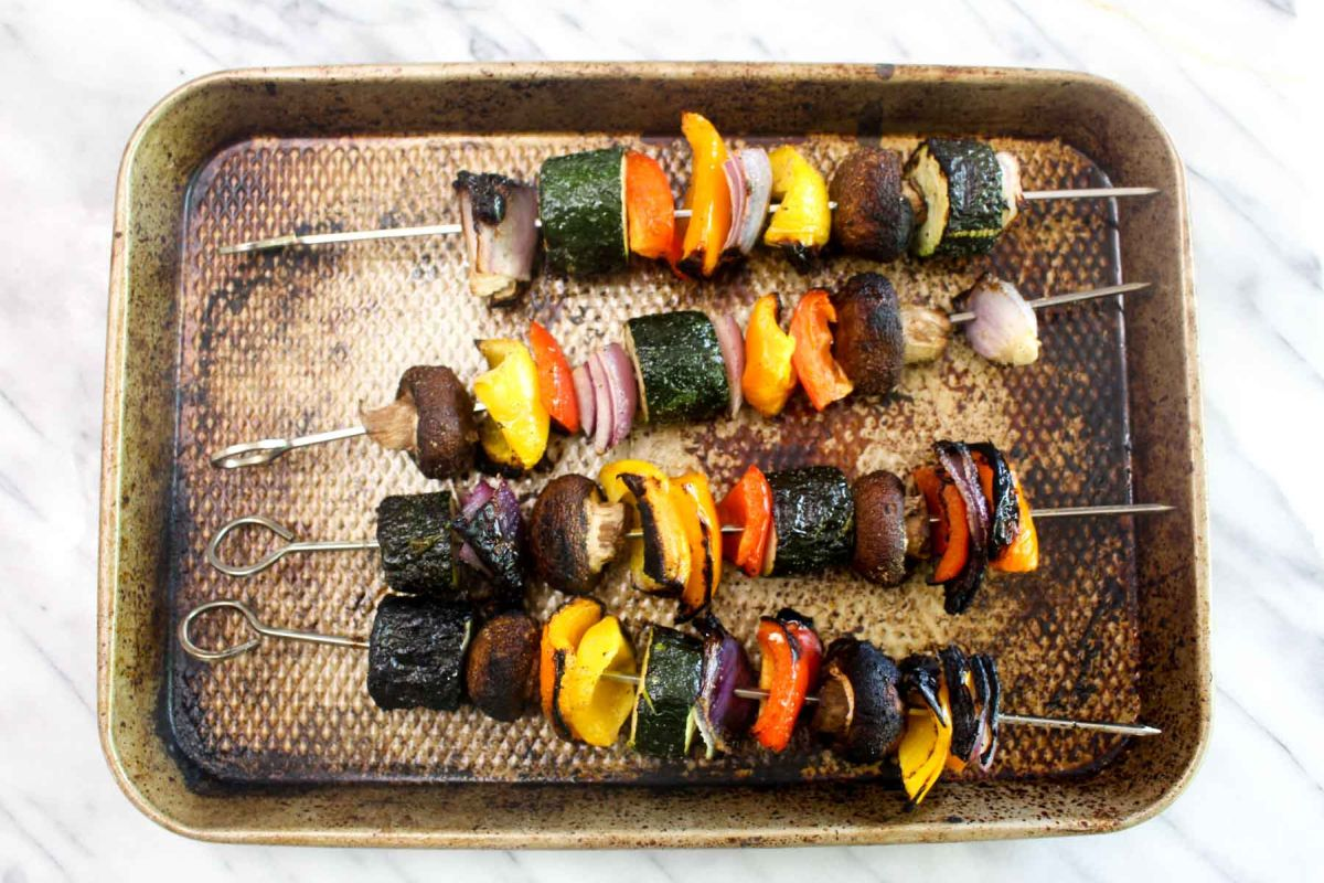 Vegetable kabobs with charred scallion chimichurri kabobs