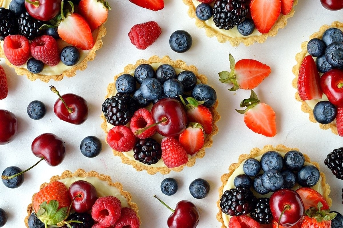 Coconut and berry fruit tarts