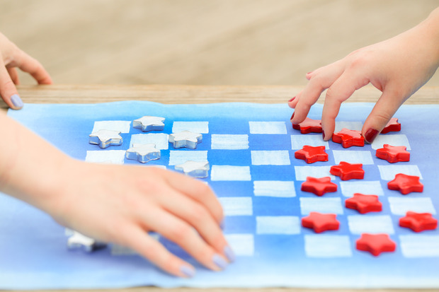 Red white and blue checkers travel game