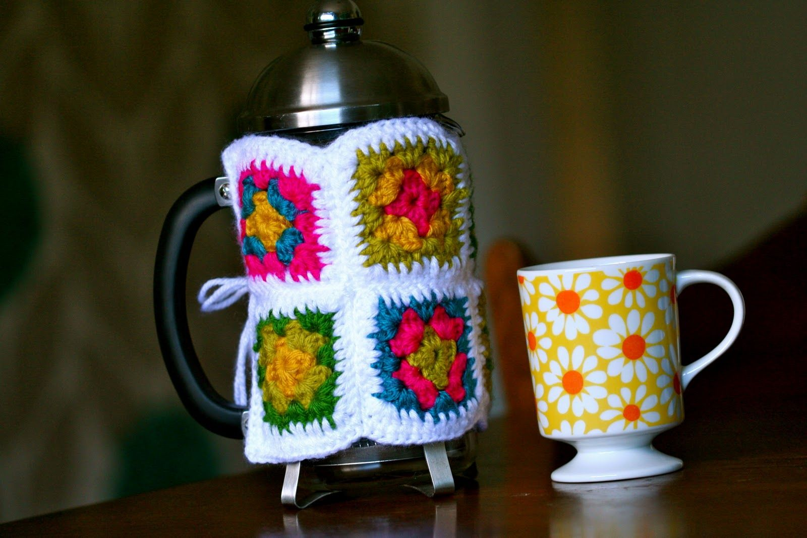 Crocheted granny square french press cozy