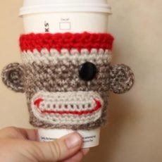Crocheted sock monkey cozy
