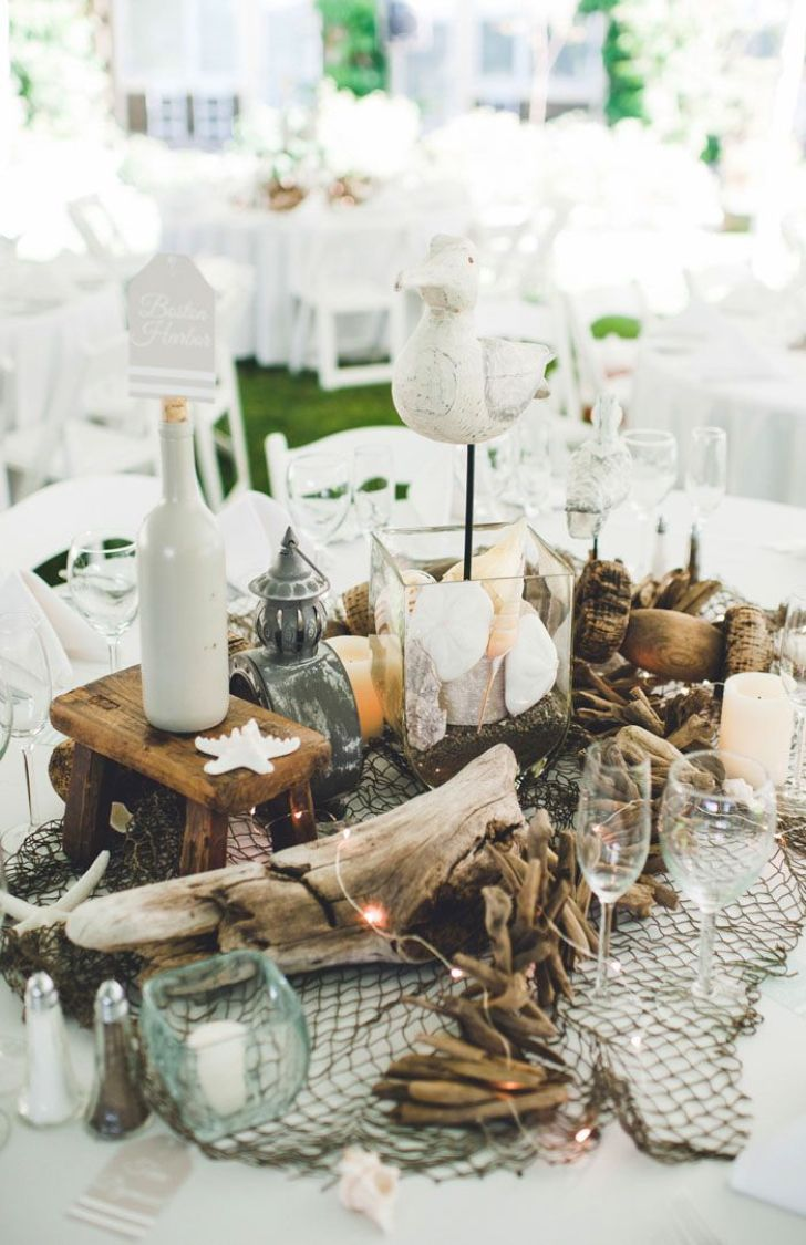 40 diy beach wedding ideas perfect for a destination celebration driftwood beach wedding reception centerpiece diy solutioingenieria Image collections