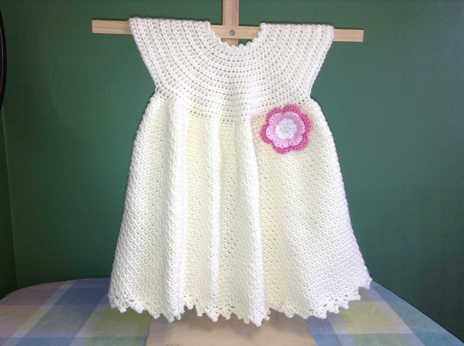 Pretty baby dress with crocheted rosette