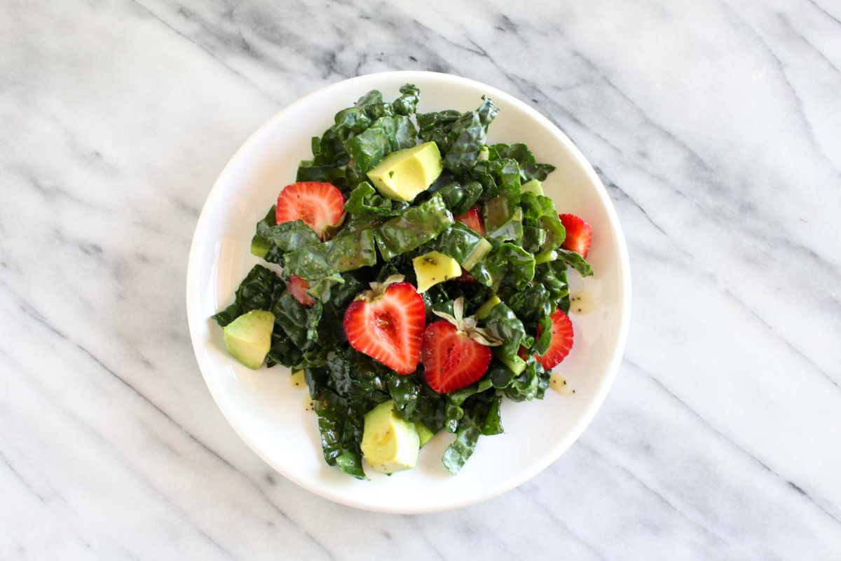 Strawberry avocado kale salad with savory granola add strawberries and dressing