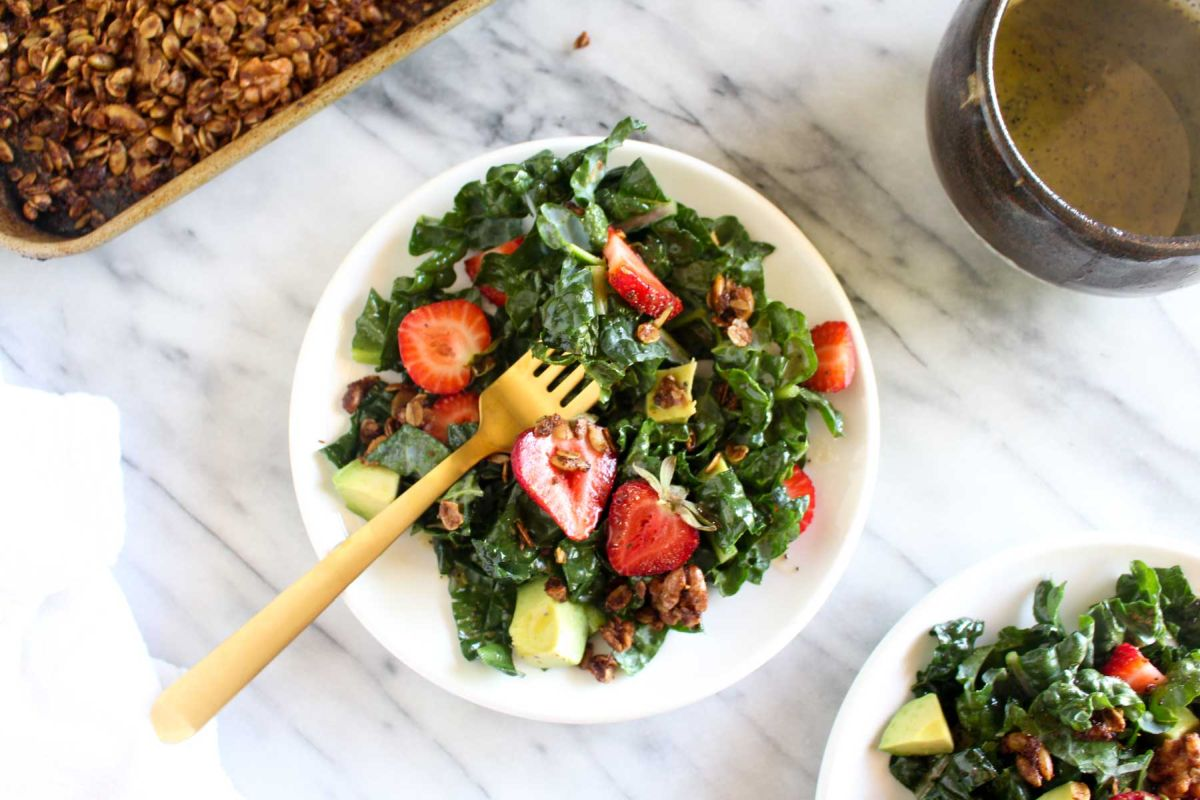 Strawberry avocado kale salad with savory granola top