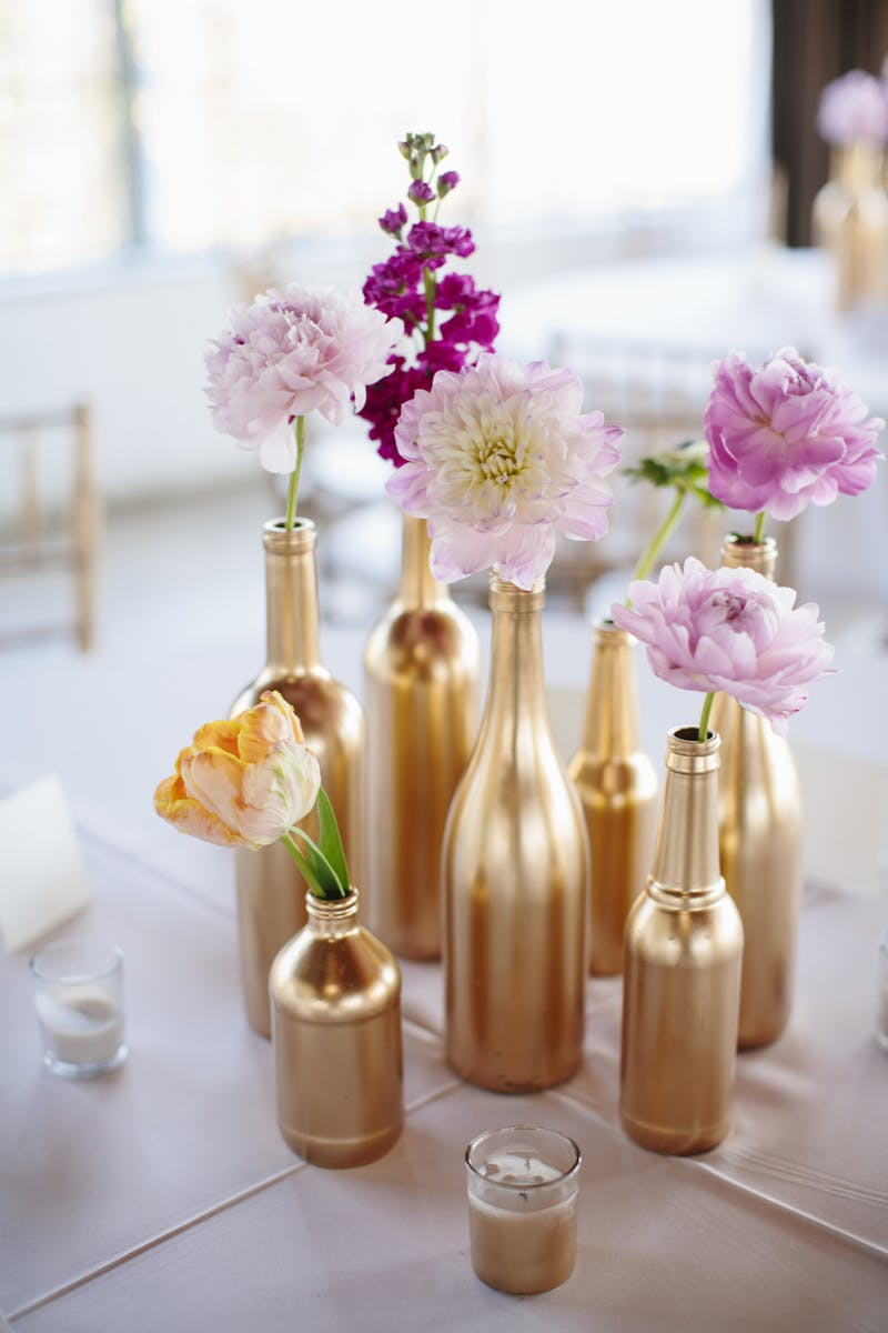 Gold painted bottles centerpiece diy