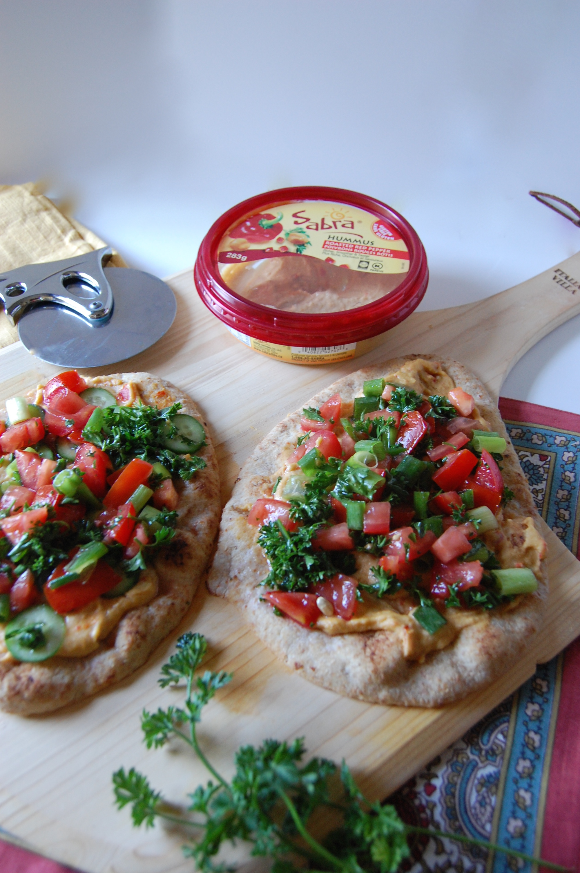 Mediterraneaon hummus naan bread pizza