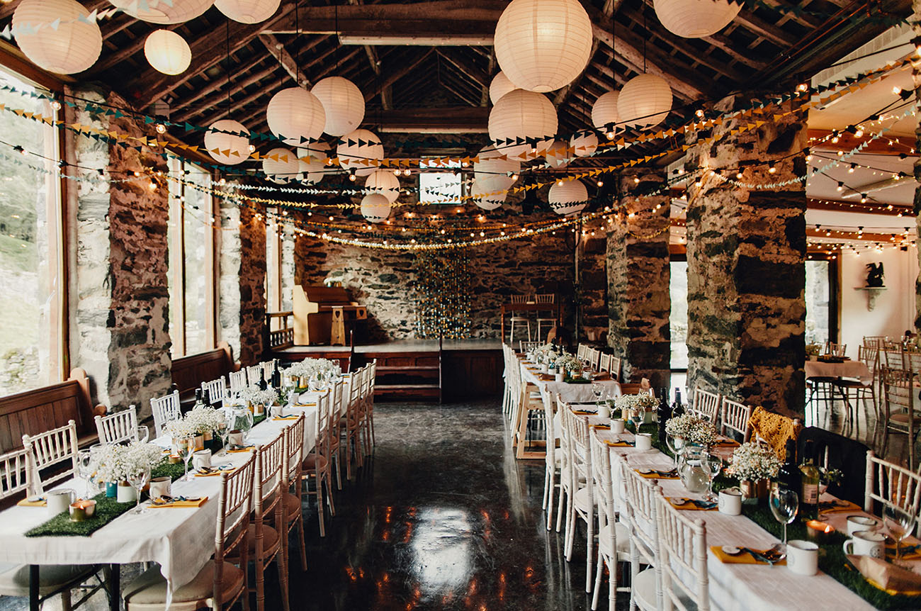 40 diy barn wedding ideas for a country flavored celebration paper lantern and bundting ceiling decor diy junglespirit Image collections