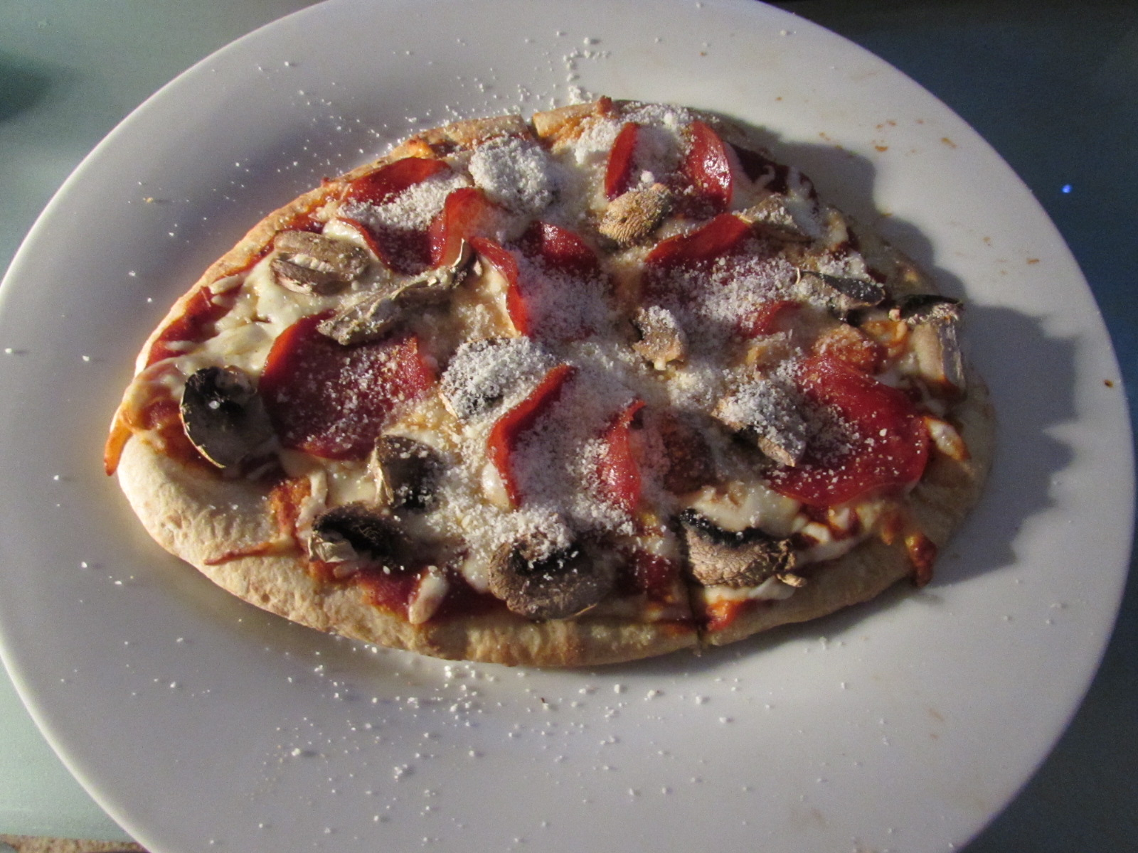 Pepperoni and mushroom naan bread pizza