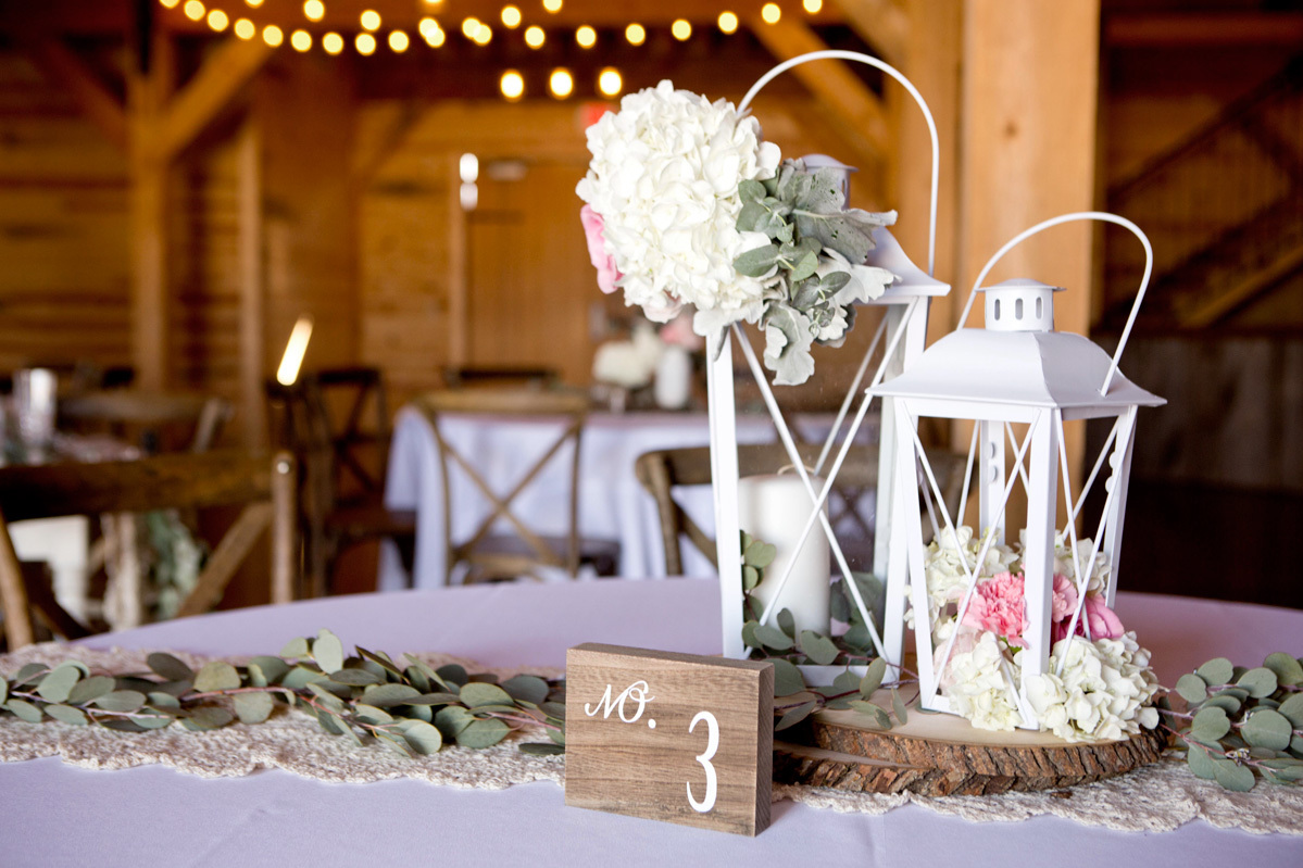 Rustic lantern wedding centerpiece