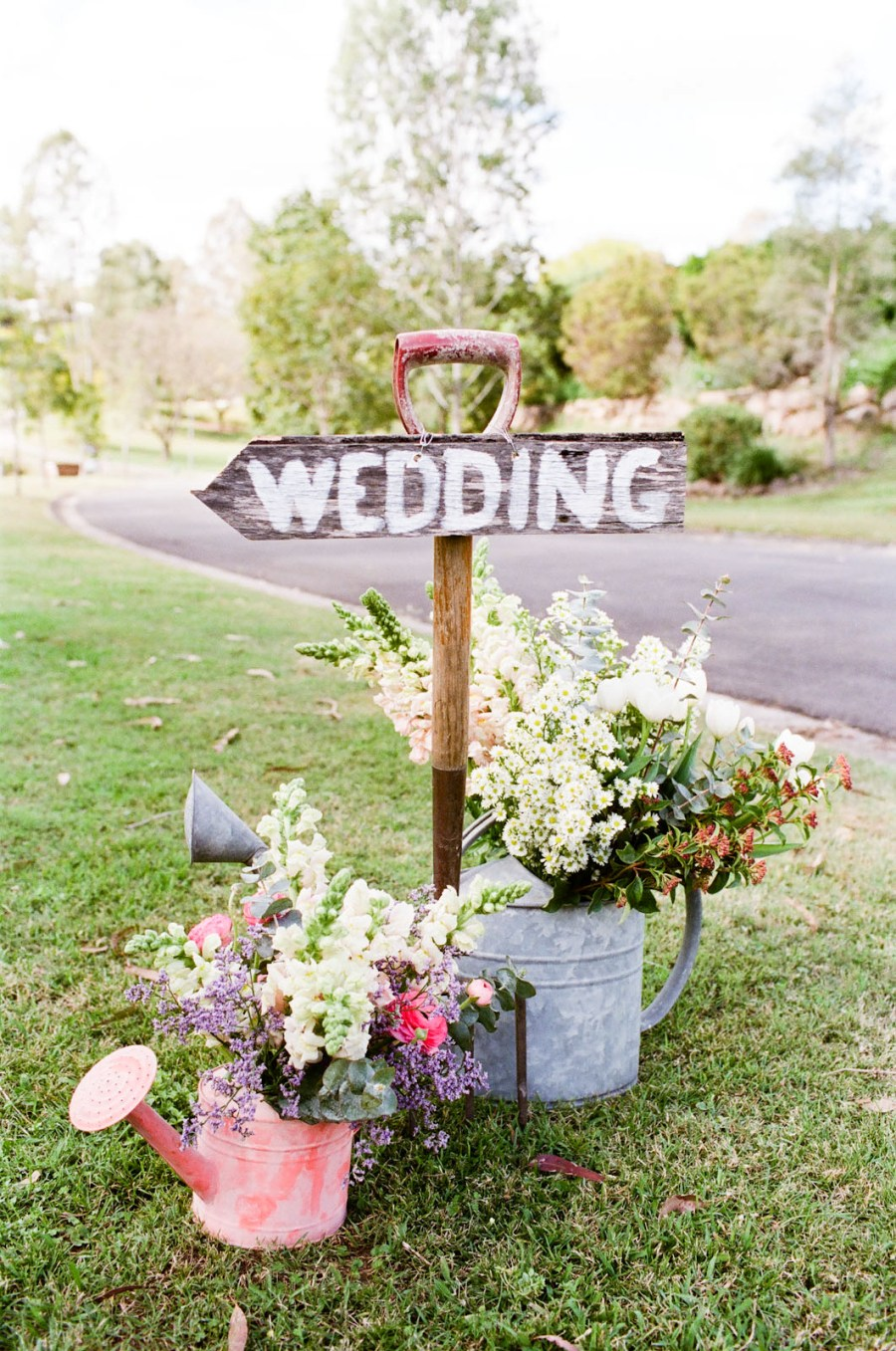 Wooden handled shovel wedding decor