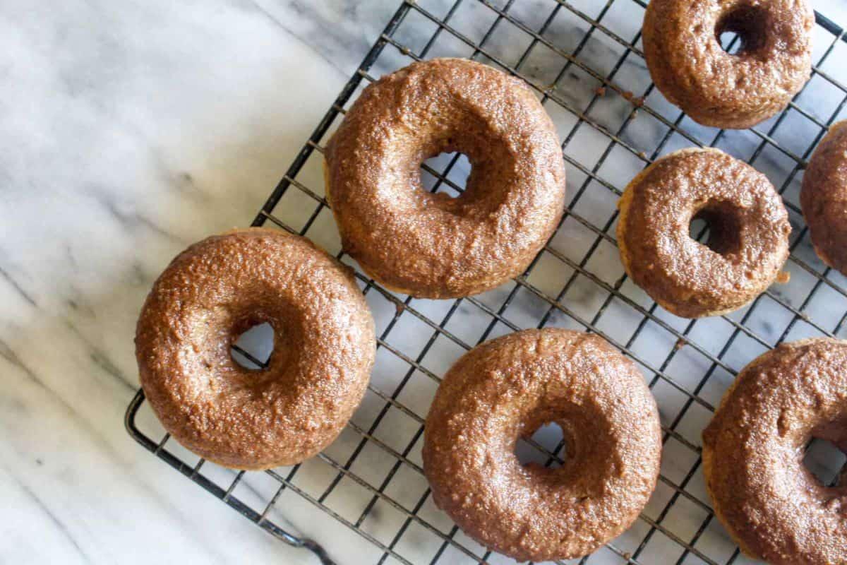 Baked pumpkin donuts with chai spice glaze serve
