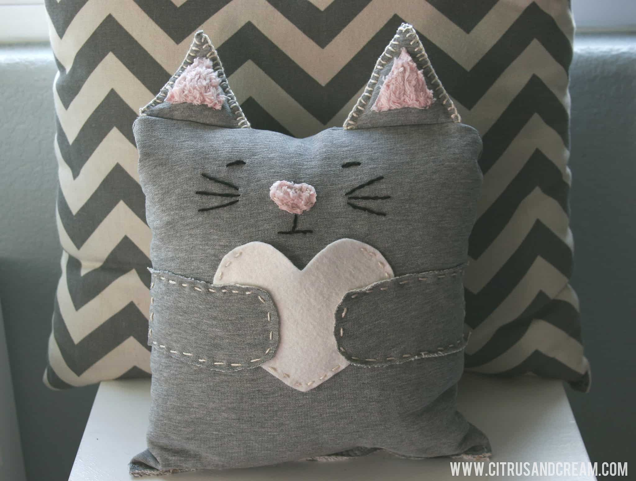 Cat pillows with ears and hearts