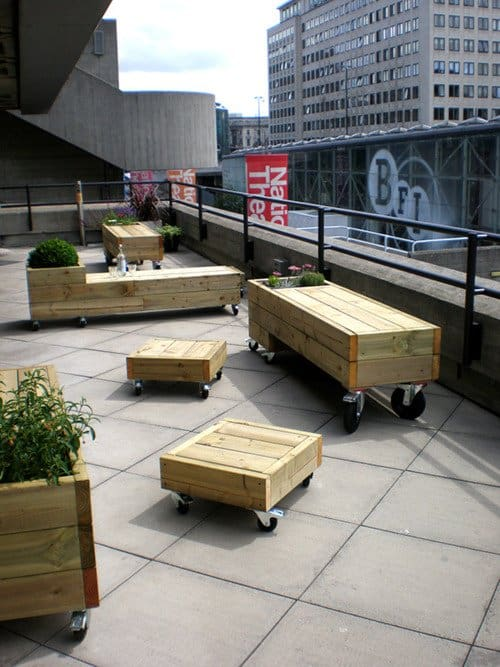 Pallet patio tables and planters on wheels