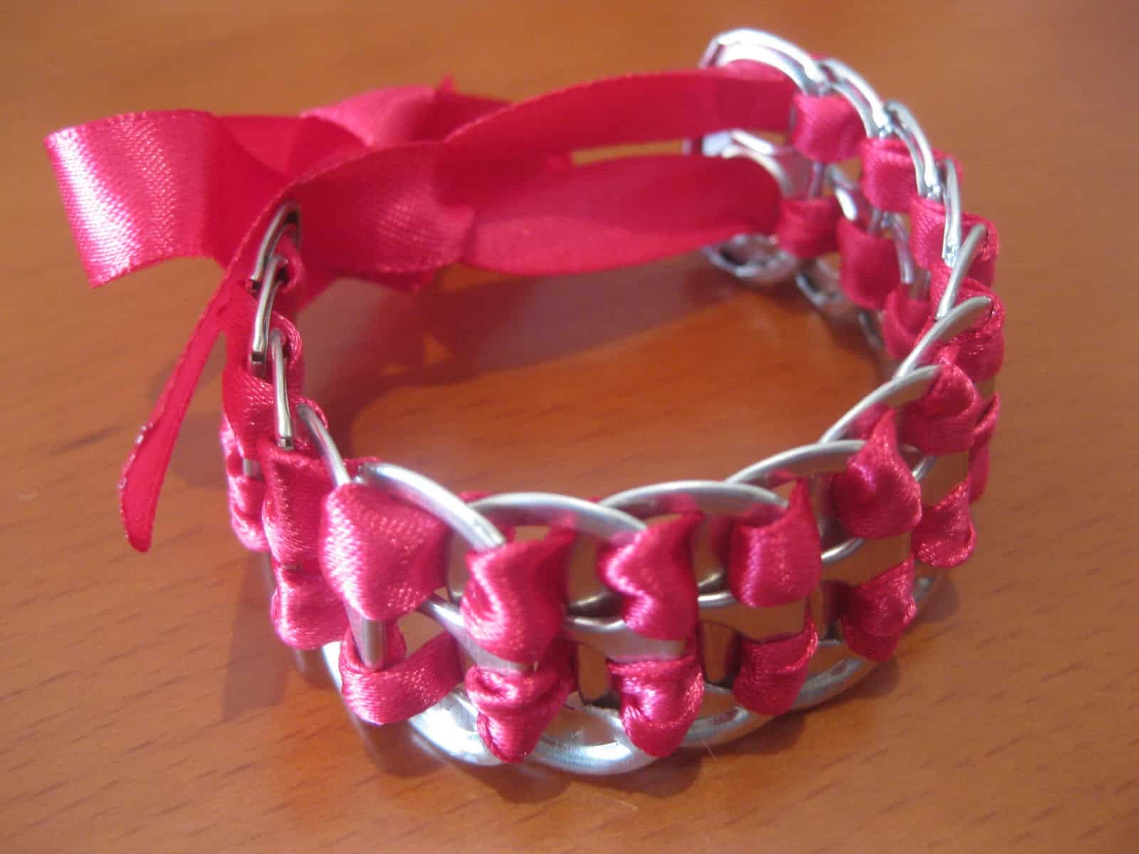 Pop tab bracelet with woven ribbons
