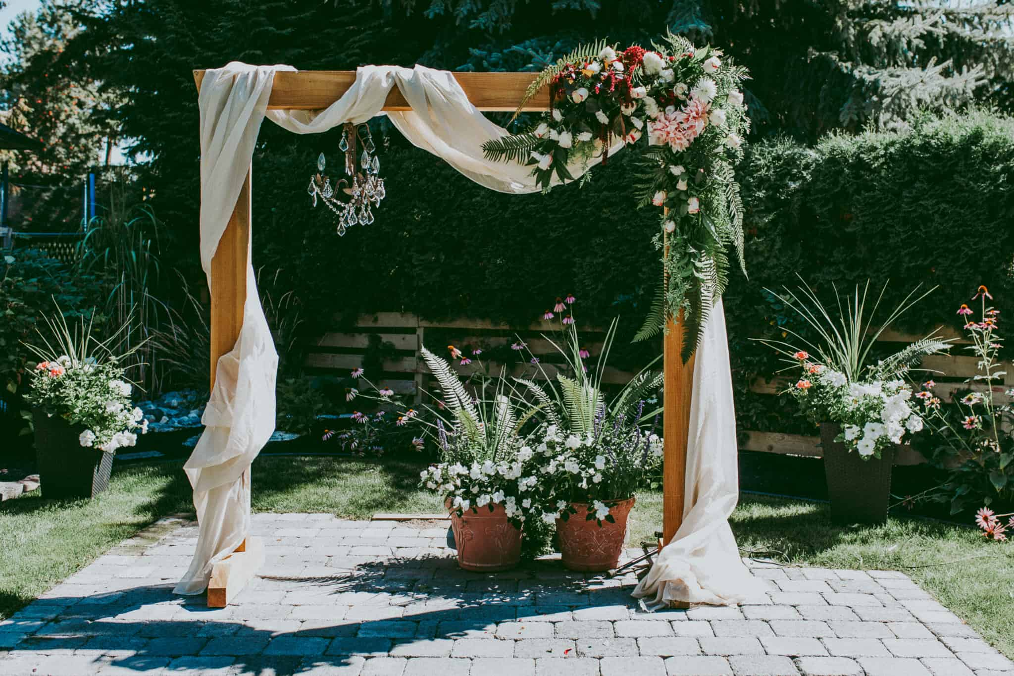 With fabric and flowers wedding arch diy