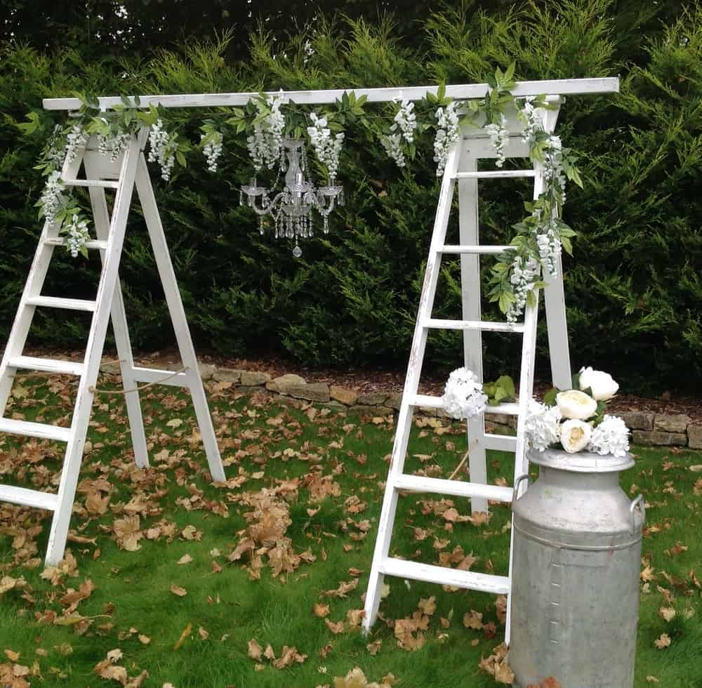 Diy ladder and chandlier wedding arch