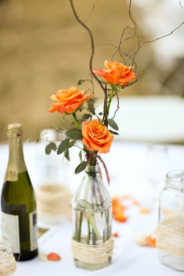 10. Orange Rose Buds Centerpiece
