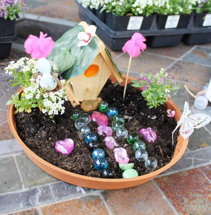 Kids enjoy making fairy gardens diy