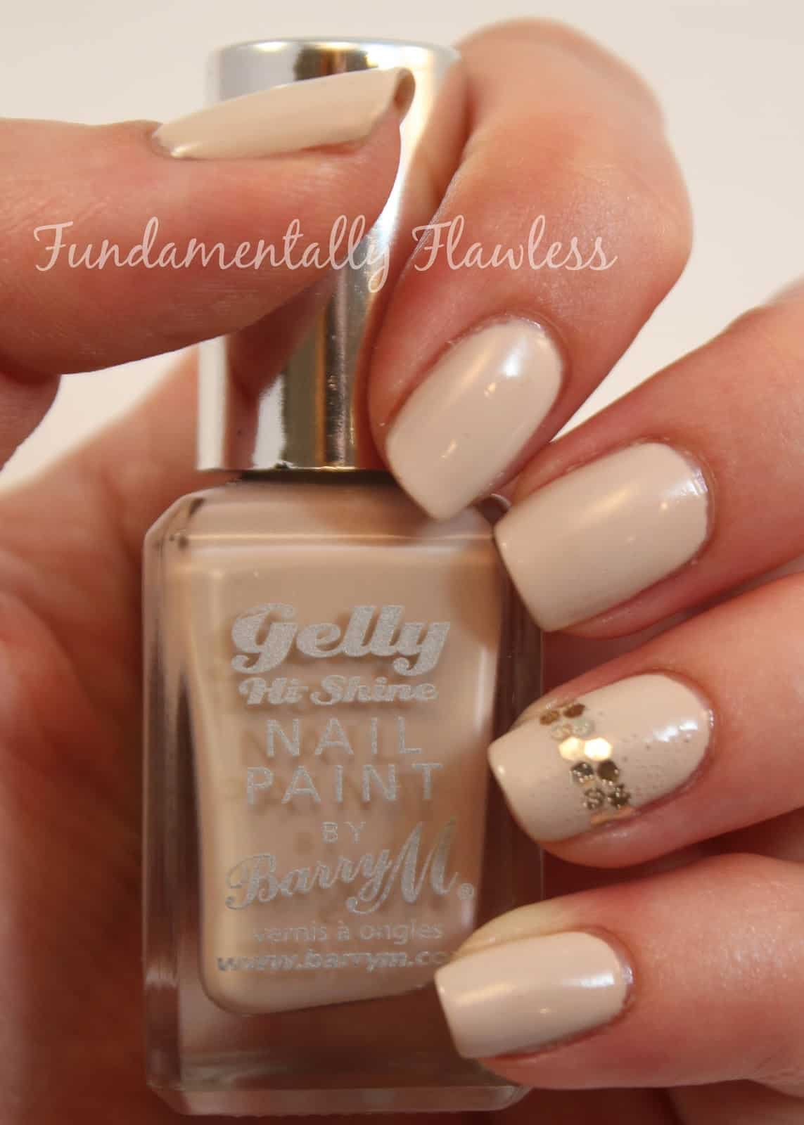 Skin tone nails with golden accents