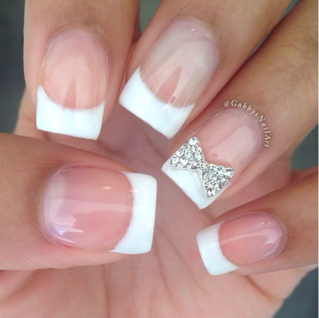 Sparkling bow with french tip wedding nails