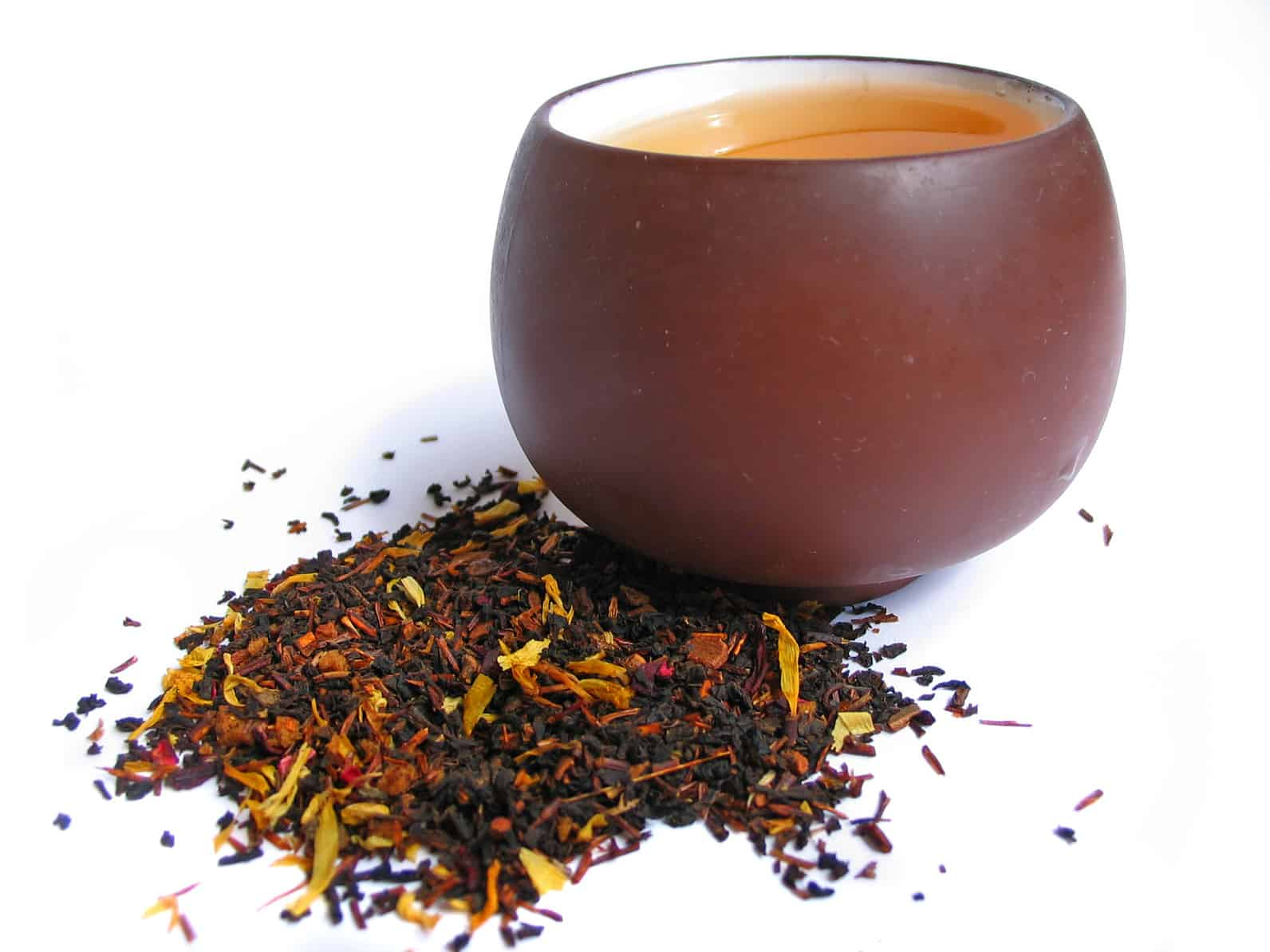 A mix black and flower tea leaves with cup of tea