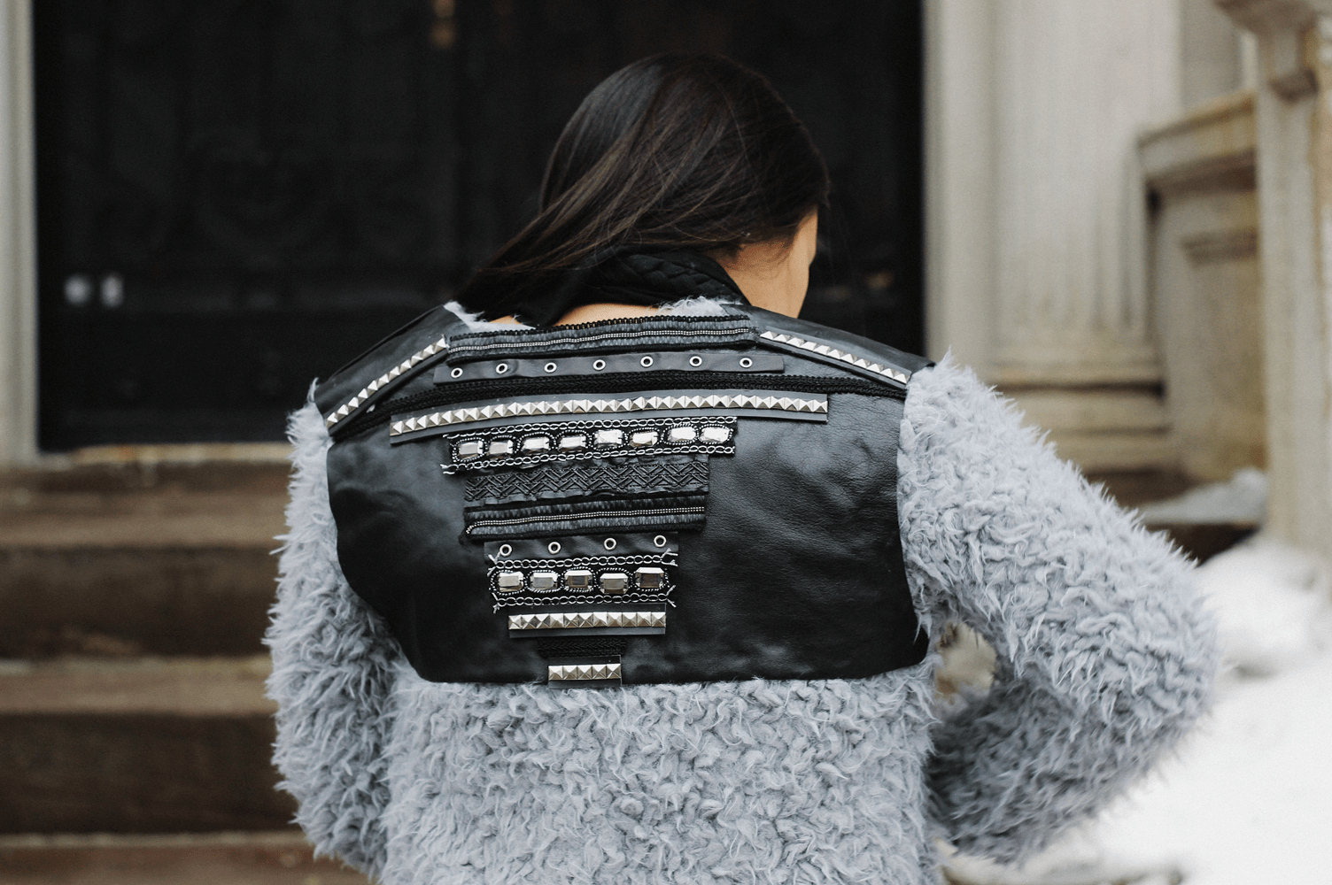 Faux fur and studded leather jacket