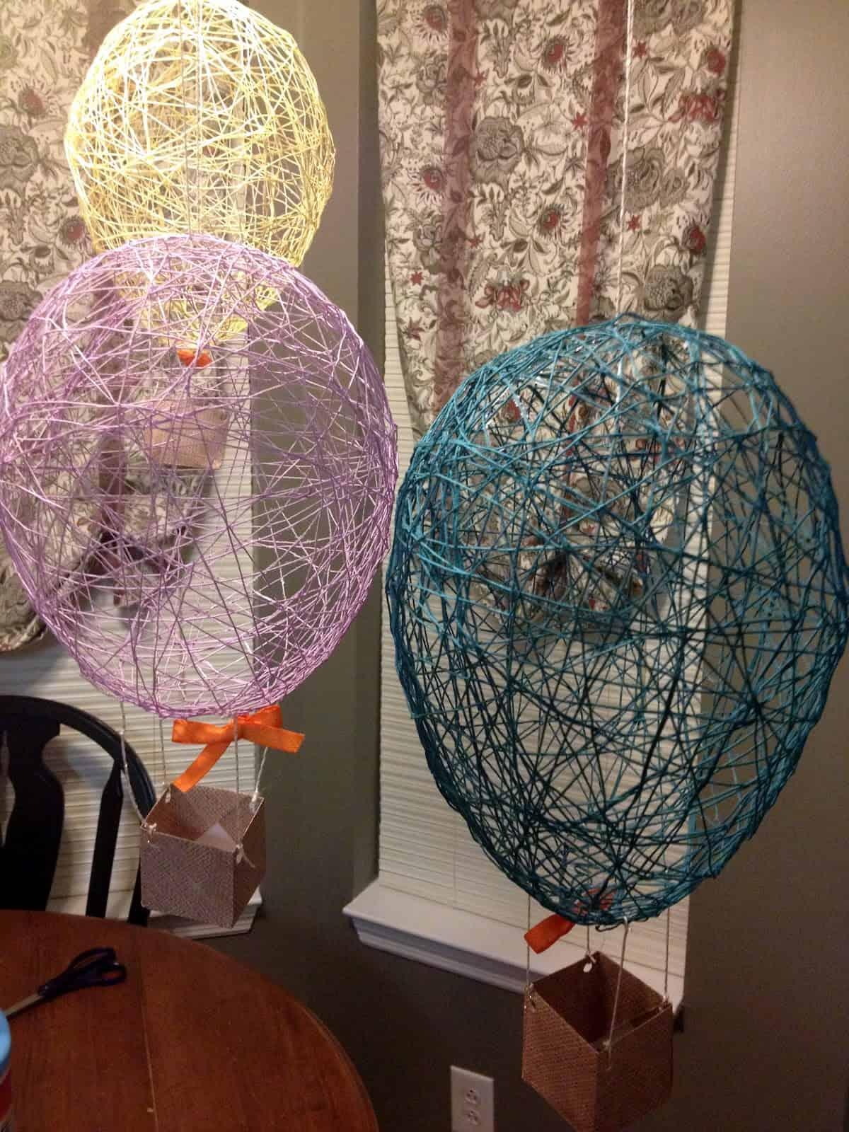 Pretty string and glue hot air balloons