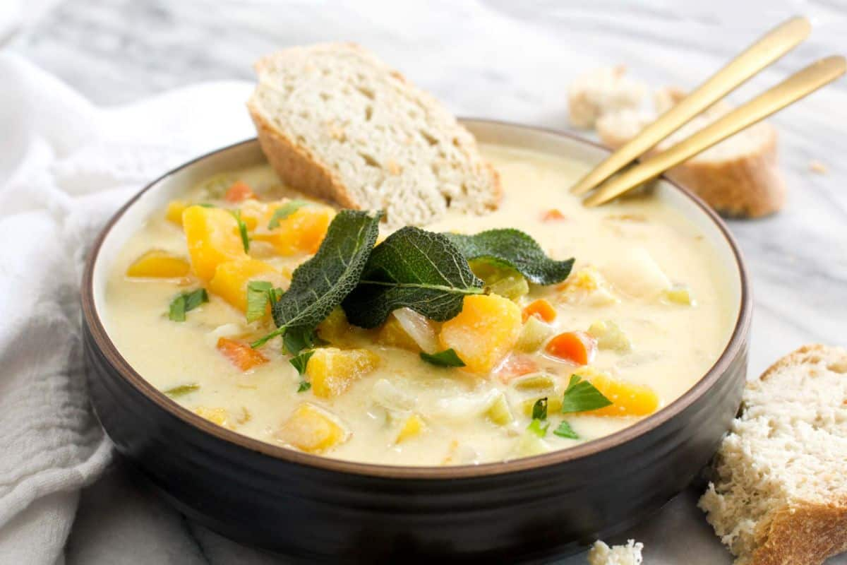 Pumpkin chowder with fried sage served with bread