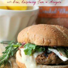 Rosemary lemon turkey burger with brie, raspberry jam, and arugula