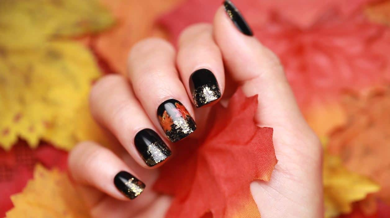 Black foilage nail art