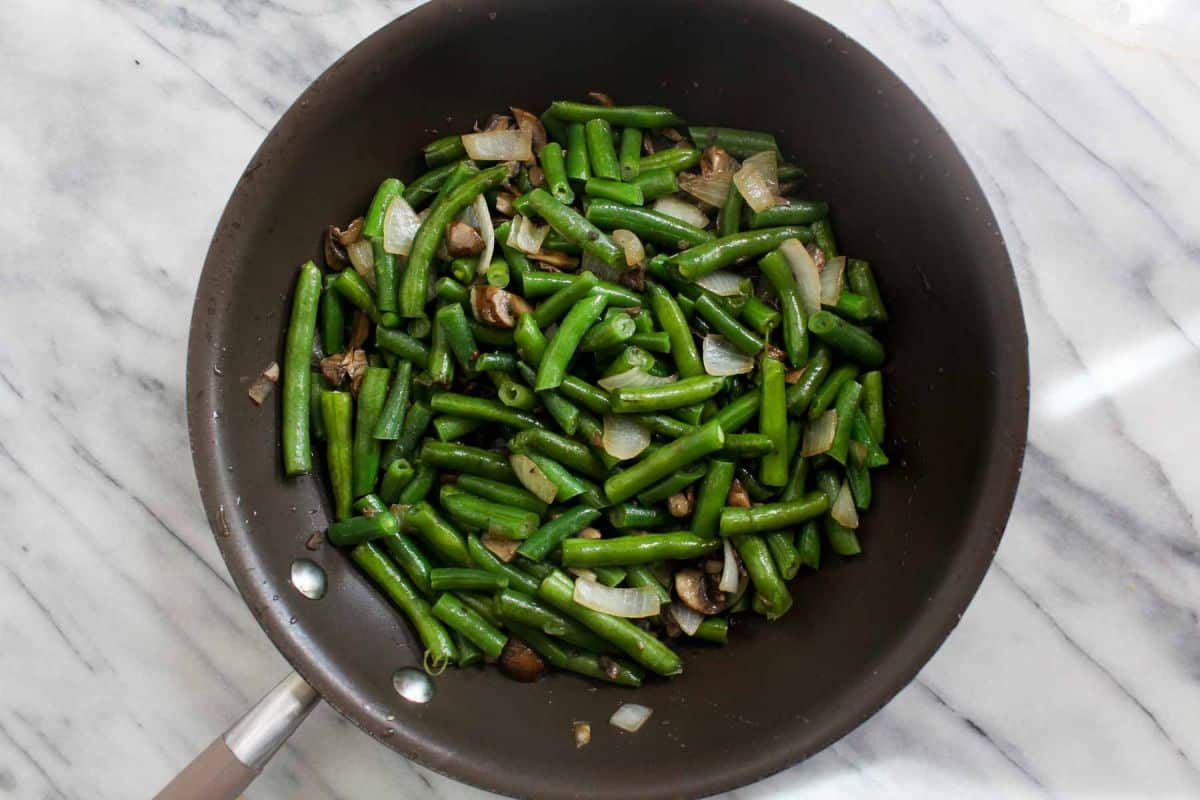 Add in the green beans and cook until crisp tender