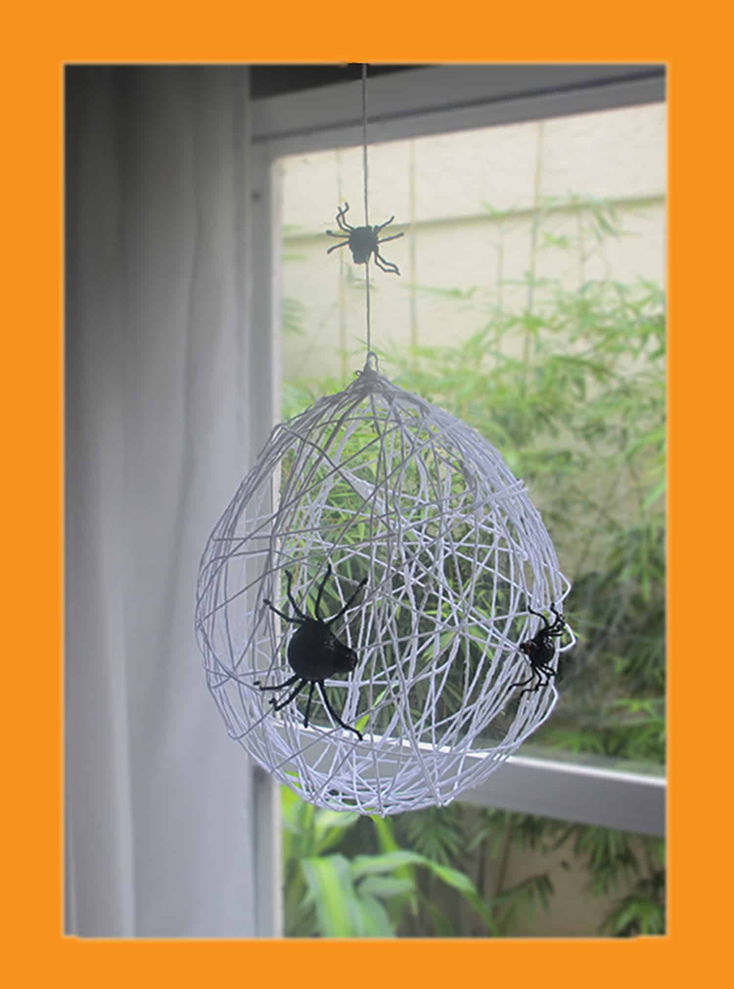 Balloon wrapped spider web mobile