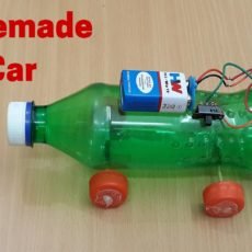 Battery powered plastic bottle car