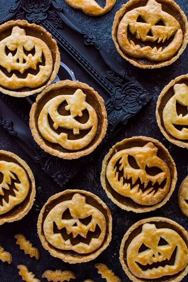Halloween Jack-O-Lantern pumpkin pies - impress your guests with these spooky treats!