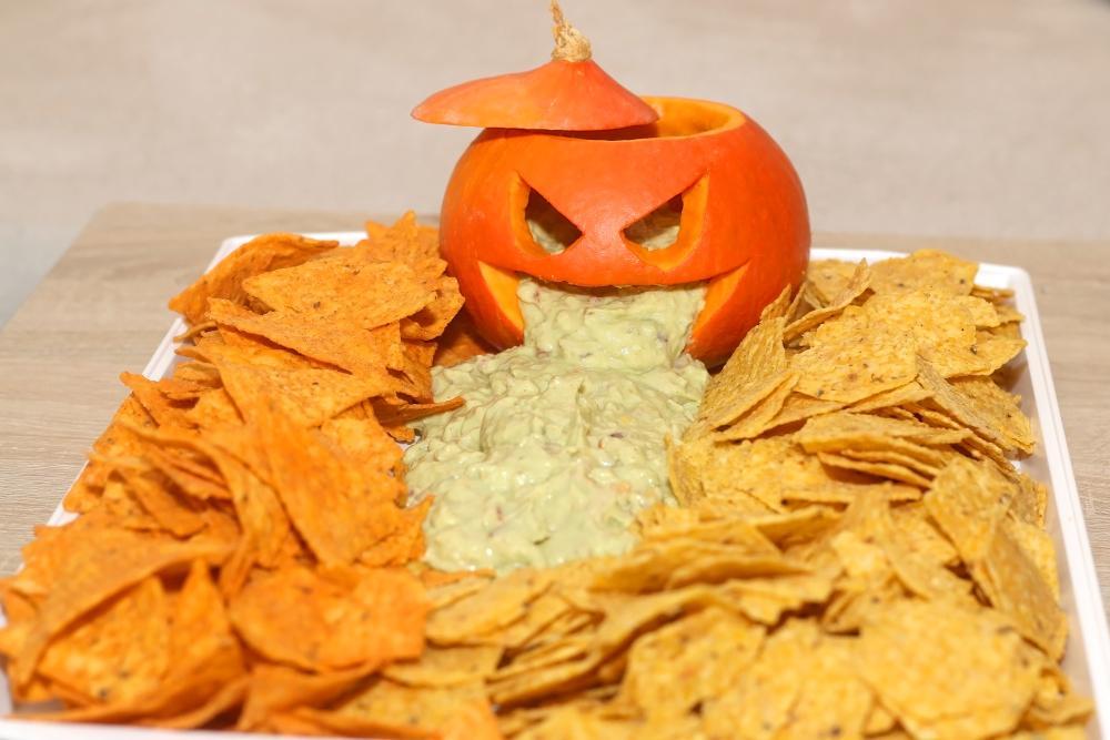 Jack o lantern tortilla guacamole platter halloween party appetizers