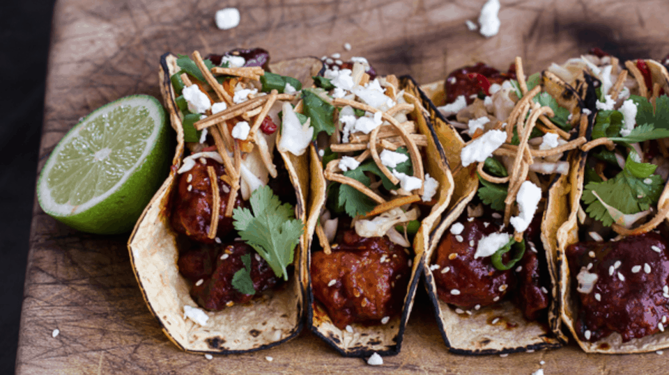 Korean fried chicken tacos with sweet slaw, crunchy noodles, and queso fresco